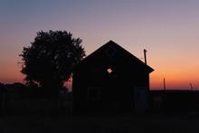 Smokey Sunset On A Farm In Montana.