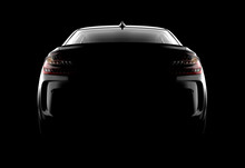 Back View Of A Generic And Brandless Modern Black Car On A Dark Background