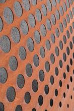 Rusty Metal Facade With Black Concrete Holes