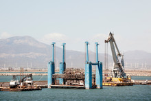 Cranes And Platforms In The Sea At A Port