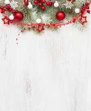 Fir Branch With Christmas Decorations On Old Wooden Shabby Background With Empty Space For Text. Top View.
