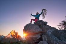Climber At The Top Of The Moun...