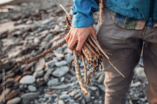 Man holding bunch of wooden sticks, Portland, Maine, USA