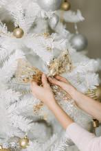 Family Preparing Christmas Tree At Home