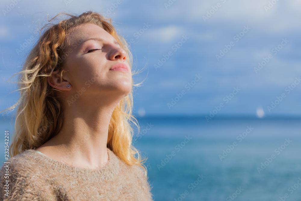 Fototapeta Happy woman outdoor wearing jumper