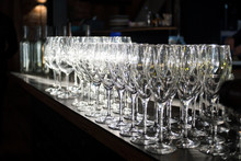 Wine Glasses Lined Up On A Bar...