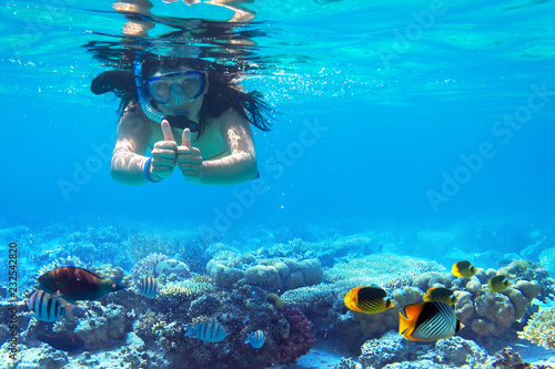 Woman at snorkeling in turquise sea water