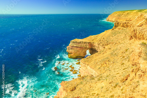 Poster Oceanië Aerial view from cliffs of Indian Ocean coastline at Natural Bridge lookout in Kalbarri National Park, Western Australia. Australian Outback travel. Blue sky, summer sunny day. Copy space.