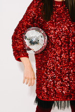 Young Woman In Red Holding Shiny Christmas Ornament
