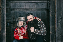 Happy Outdoor Portrait Of Bearded Hipster Father Posing With Blo