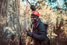 A Young Man Smiles During An Outdoor Zip Line Course