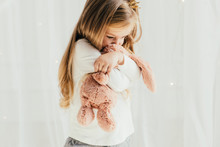 Child Hugging A Toy