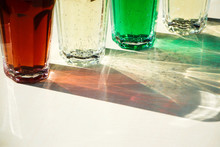 Close Up Of Colorful Lemonade Drinks In Glass