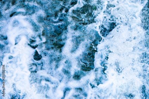 Deurstickers Kristallen white foam on blue water close up, image for background