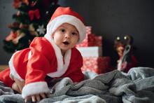 Adorable Little Boy In Santa Suit