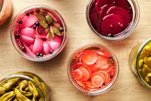 CLose-up Of Colorful Pickled Vegetables In Jars