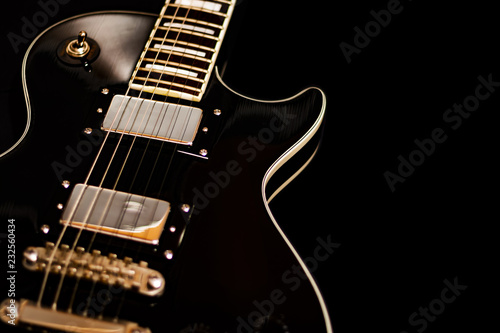 Photo  Isolated electric guitar on black background