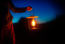 Hand Holds A Large Old Lamp In...
