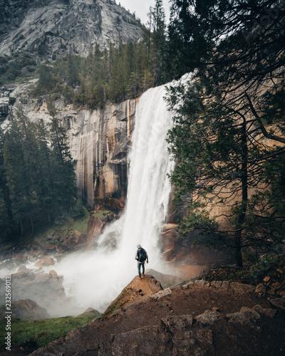 Man overlooking waterfall in Yosemite National Park - 232569013