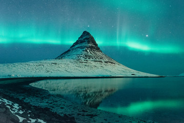 Northern lights over snowy ...