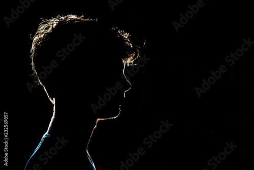 Fotografie, Tablou silhouette of man head on dark black background with lighten circuit contour f