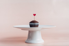 One Single Cupcake With A Red ...