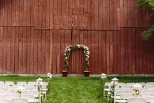 Wedding Arbor In Front Of Rust...