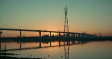Timelapse Of The Sun Rising Behind The Westgate Bridge And Melbourne Cityscape.