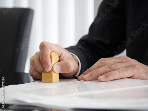Photo 角印を押す司法書士の手元