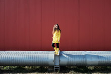 Woman In Yellow On Pipeline