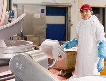 Man Working At Modern Meat Factory