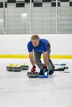Curling: Man Throwing Stone During Game Play