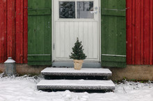Small Christmas Tree On Porch