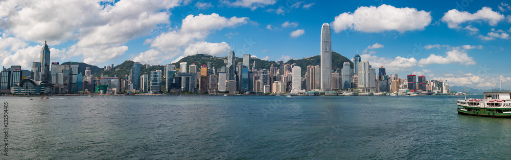 Fototapeta Wide Panorama of Hong Kong skyline at daytime