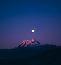 Moon Rising Behind The Peak Of...