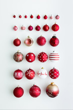 Red Christmas Ornaments On White