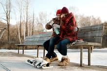 Couple Warming Up After Skating