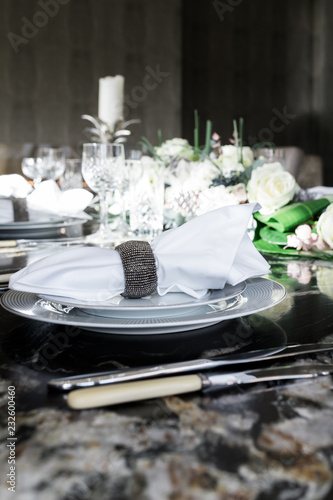 Closeup of a luxury table setting and napkin.