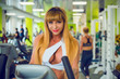 Fit mature woman work in GYM. Exercises for middle age lady, bodybuilder train, sports lifestyle