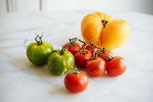 Fresh Heirloom Tomatoes On A Kitchen Table