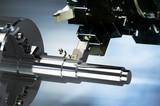 Fototapeta Sport - Industrielle Bearbeitung von Metall mit CNC Drehmaschine