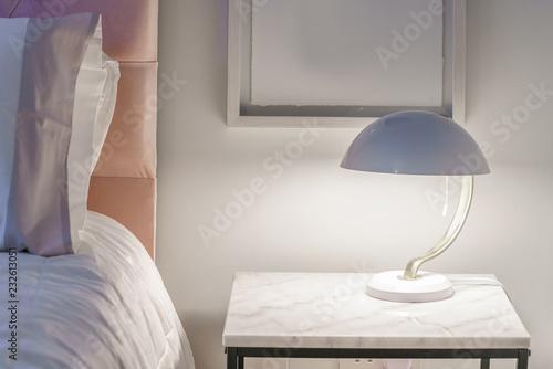 Table lamp in a bedroom Wallpaper Mural