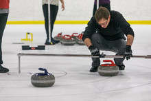 Curling: Man Uses Device To Mesure Closest Stone