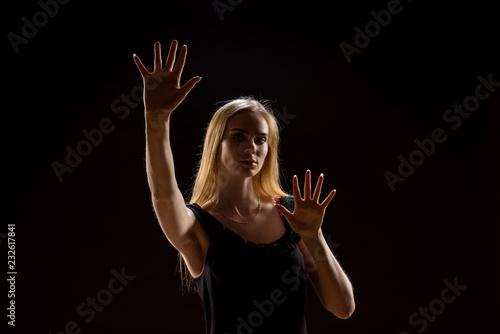 Fotografie, Obraz  Young woman waving her hands