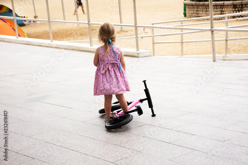 Obraz na plátne English children girl practice cycling at outdoor at Repulse Bay in Hong Kong, C
