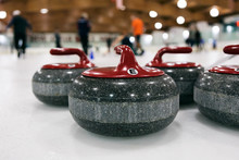 Curling: Red Team Stones Wait On Ice