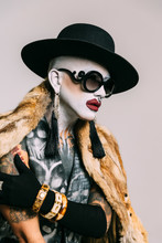 Bizarre Fashion Studio Portrait With Extreme Makeup