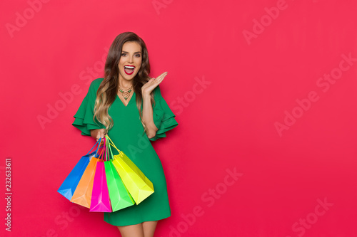 Fototapeta Excited Fashion Woman Is Holding Colorful Shopping Bags And Shouting obraz