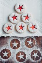 Linzer Cookies On A Plate An Powdered Sugar Marks