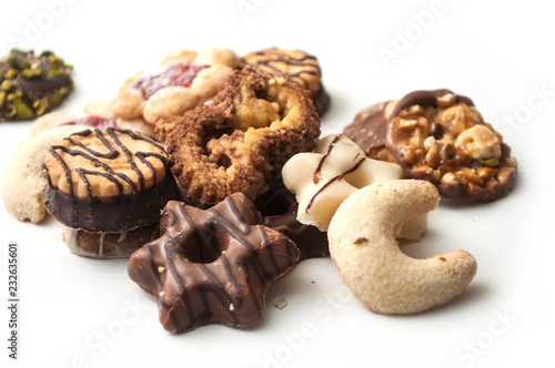 closeup of chocolate christmas biscuit assortment on white background Fotobehang